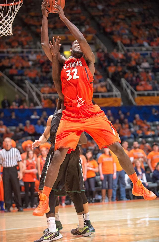 Illinois' Nnanna Egwu (32) pulls down a rebound over the back of Chicago State's Quinton Pippen during the second half of an NCAA college basketball game on Friday, Nov. 22, 2013, in Champaign, Ill. Illinois defeated Chicago State 77-53. (AP Photo/Darrell Hoemann)