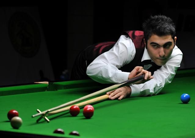 Iran's Hossein Vafaei Ayouri plays a shot during the IBSF World Snooker Championship in Bangalore on December 03, 2011. Hossein Lee Walker of Wales by 10 frames to nine. AFP PHOTO/Manjunath KIRAN (Photo credit should read Manjunath Kiran/AFP/Getty Images)