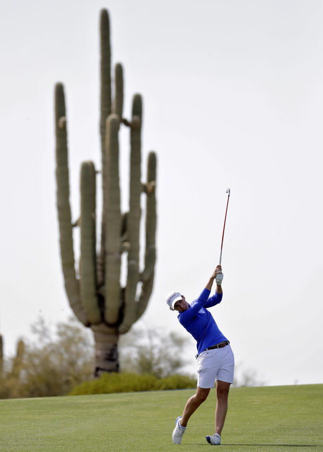Carlota Ciganda hits from the fifth fairway during the final round of the Founders Cup LPGA golf tournament Sunday, March 24, 2019, in Phoenix. (AP Photo/Matt York)