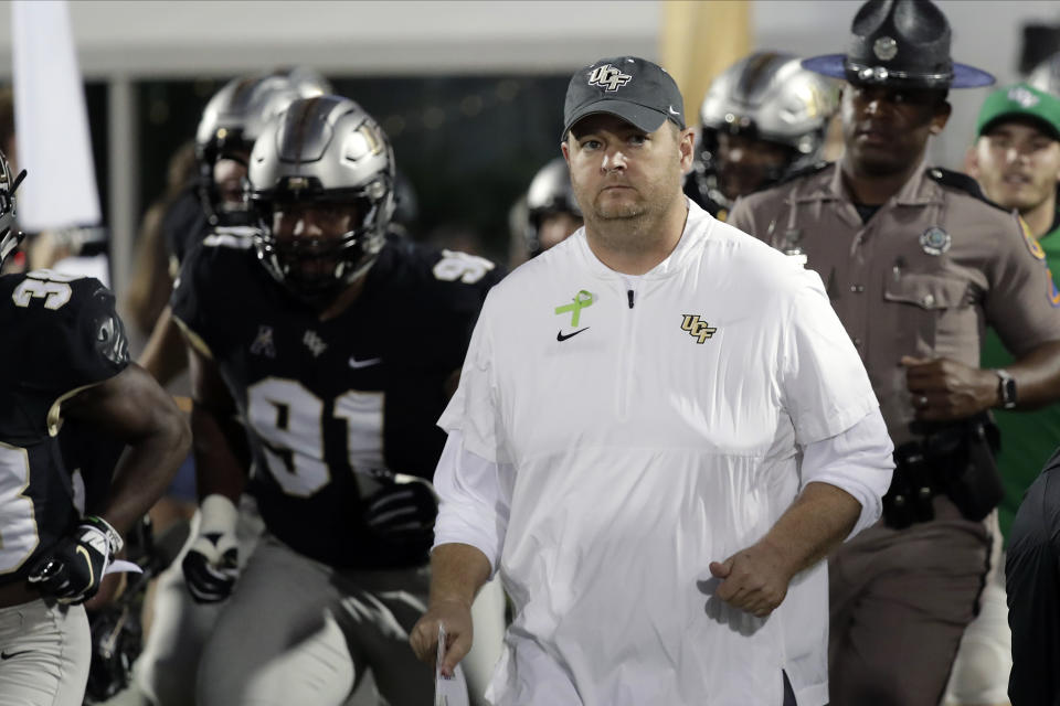 Central Florida head coach Josh Heupel takes the field with his players before the first half of an NCAA college football game against East Carolina, Saturday, Oct. 19, 2019, in Orlando, Fla. (AP Photo/John Raoux)