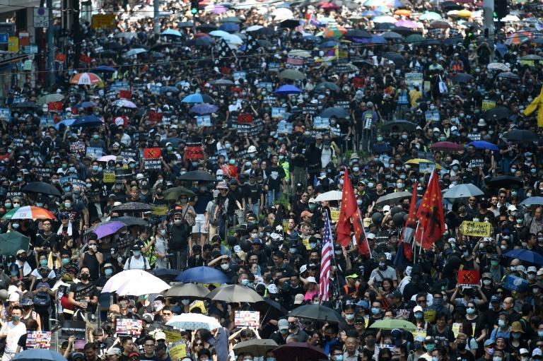 The largest unsanctioned rally kicked off in Causeway Bay district (AFP Photo/Mohd RASFAN)