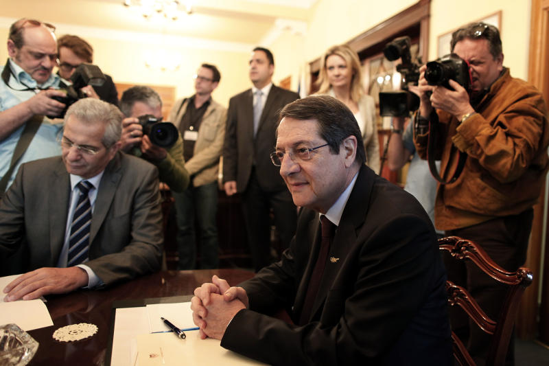 During a crucial top level meeting of Cypriot leaders including Cyprus' President Nicos Anastasiades, right, and AKEL party chief Andros Kyprianou, left, take part in a meeting with various party leaders and governor of the Central Bank of Cyprus, not pictured, at the presidential palace in Nicosia Wednesday, March 20, 2013. Cypriot lawmakers have rejected a critical draft bill that would have seized part of people's bank deposits in order to qualify for a vital international bailout. (AP Photo/Petros Giannakouris)