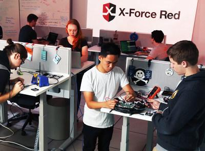 Members of IBM X-Force Red, a team of seasoned hackers, testing for security issues in consumer electronics at a new secure testing facility in Austin, TX, Monday, August 6, 2018. In the Lab, the team will search for vulnerabilities in consumer and industrial IoT technologies, automotive equipment, ATMs and other systems before and after they are put into market. The Austin facility is one of four X-Force Red Labs, announced today by IBM Security. (Jack Plunkett/Feature Photo Service for IBM)