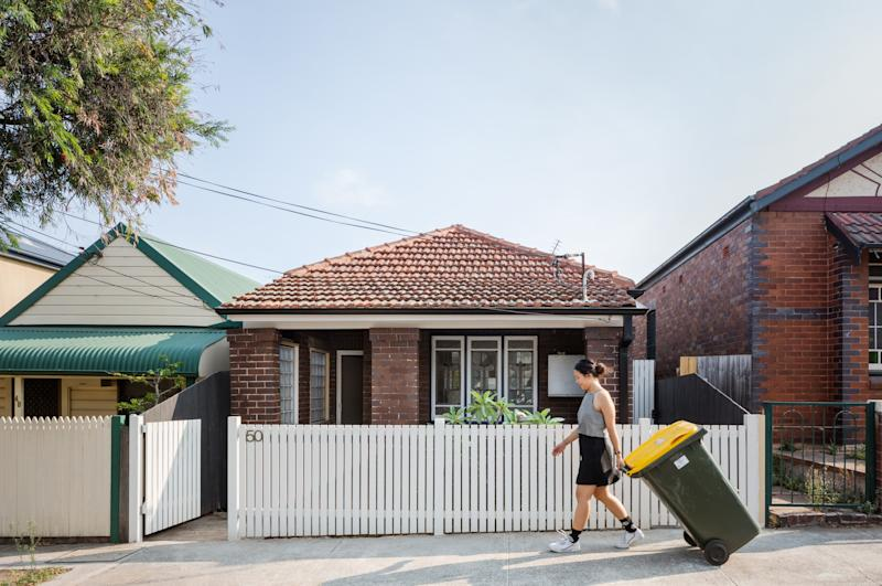 """The renovation kept the home's original Federation-style exterior facing the street and its front rooms. """"The original part of the house is in fairly good condition,"""" architect Qianyi Lim says."""