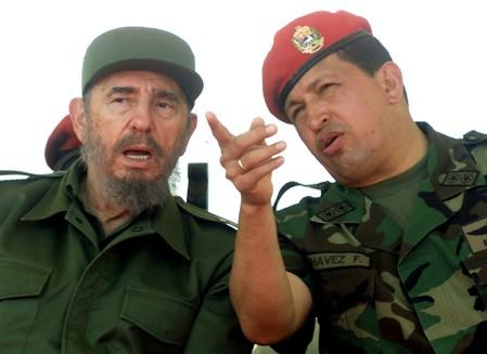 FILE PHOTO: Venezuelan President Hugo Chavez talks with Cuban President Fidel Castro at the port of Pampatar on Margarita Island