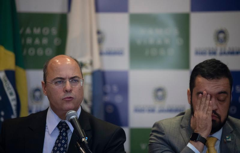 Rio de Janeiro's Governor Wilson Witzel (L) speaks next to Rio de Janeiro's Vice-Governor Claudio Castro during a press conference in Rio de Janeiro, Brazil, on September 23, 2019, after eight-year-old Agatha Sales Felix died during a police operation at the Alemao complex slum. - Felix was killed by a stray bullet during a confrontation between alleged drug traffickers and police officers on September 21. (Photo by MAURO PIMENTEL / AFP) (Photo credit should read MAURO PIMENTEL/AFP via Getty Images)