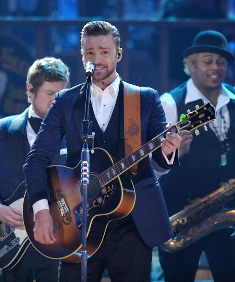 FILE - In this Nov. 24, 2013 file photo, Justin Timberlake performs on stage at the American Music Awards at the Nokia Theatre L.A. Live in Los Angeles. Timberlake was among the top nominees for the 56th annual Grammy Awards announced Friday night, Dec. 6, 2013. (Photo by John Shearer/Invision/AP, File)