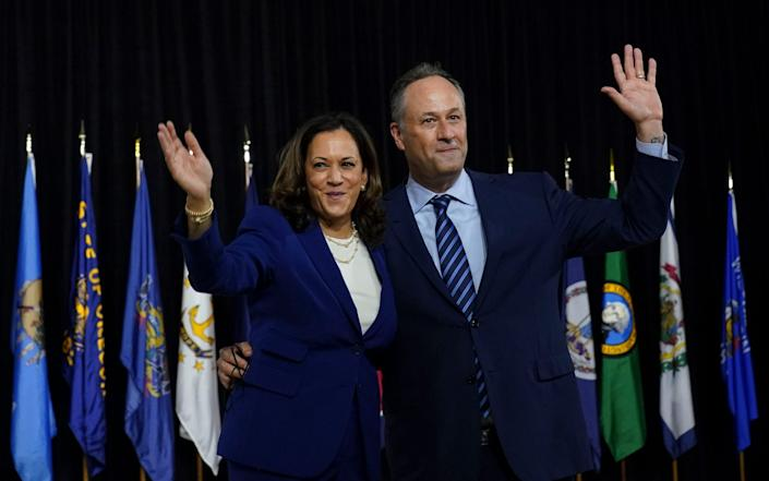 Kamala D. Harris and her husband Doug Emhoff wave after she was introduced by Joe Biden as his running mate - The Washington Post /The Washington Post