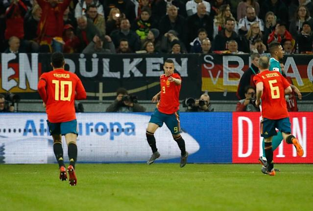 Centre forward Rodrigo made a point after Spain's No. 6 Iniesta helped set up Spain's early goal against Germany (AFP Photo/Odd ANDERSEN)