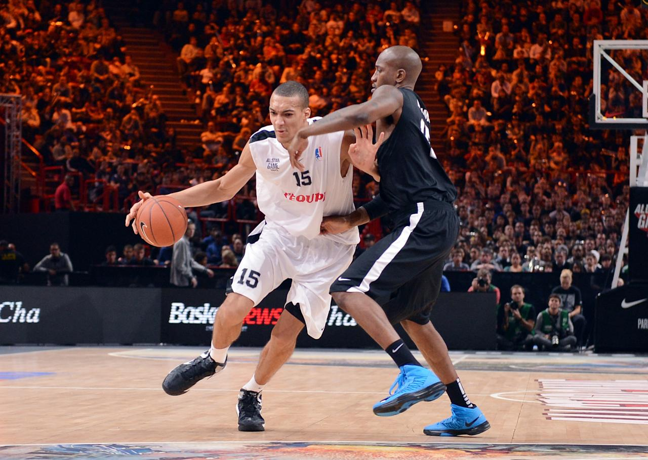 French All star player Rudy Gobert (L) vies against a Foreign ProA All Star players during the France's national basketball league (LNB) 2012 All Star Game on December 30, 2012 at the Palais Omnisport de Paris-Bercy (POPB) in Paris. AFP PHOTO MIGUEL MEDINAMIGUEL MEDINA/AFP/Getty Images