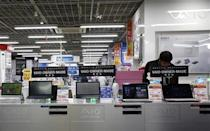 A shopper looks at Sony Corp's Vaio PCs at an electronics retail store in Tokyo February 5, 2014. REUTERS/Yuya Shino