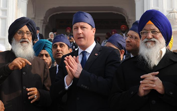 David Cameron and Theresa May visited India, which is a key economic partner - PA