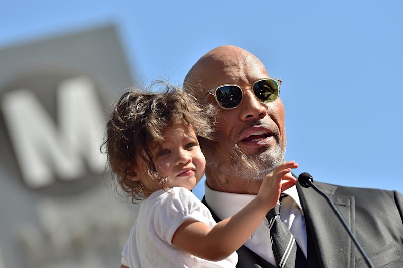 Dwayne Johnson said he, his two young daughters and his wife all caught COVID-19. (Photo by Axelle/Bauer-Griffin/FilmMagic)