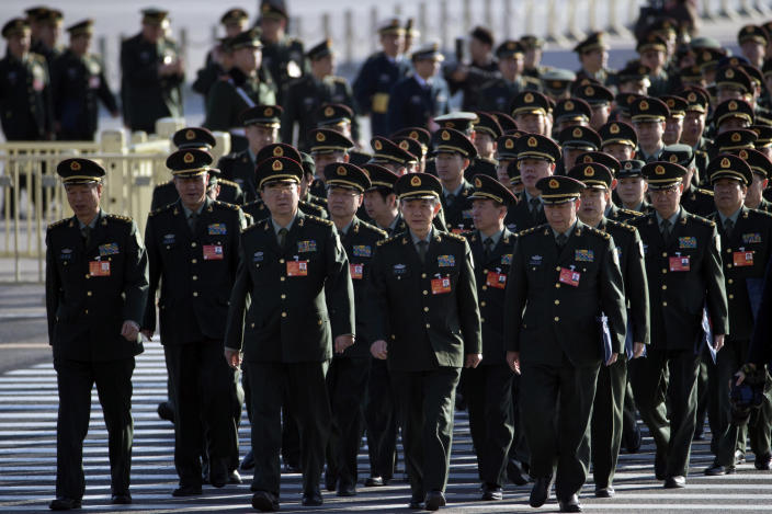 Delegates from Chinese People's Liberation Army (PLA) march from Tiananmen Square to the Great Hall of the People to attend sessions of National People's Congress and Chinese People's Political Consultative Conference in Beijing, China, Tuesday, March 4, 2014. (AP Photo/Ng Han Guan)