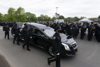 Thousands of police officers line the street as the hearse bearing New York police officer Anastasios Tsakos leaves the St. Paraskevi Greek Orthodox Shrine Church, Tuesday, May 4, 2021, in Greenlawn, N.Y. Tsakos was at the scene of an accident on the Long Island Expressway when he was struck and killed by an allegedly drunk driver a week ago. (AP Photo/Mark Lennihan)