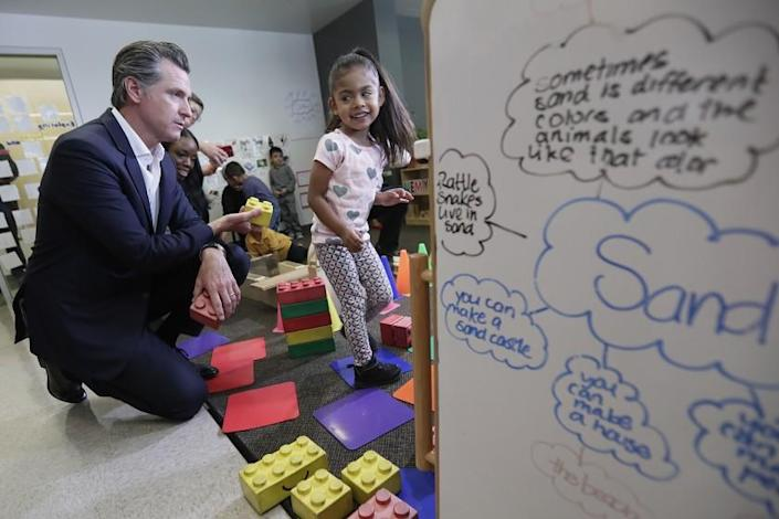 LOS ANGELES, CA, THURSDAY, AUGUST 8, 2019 - California Governor Gavin Newsom stacks blocks with Nahomy Corona, 4, while visiting the Hope Street Family Center to promote the StateÕs investment of $2 billion in early childhood development. (Robert Gauthier/Los Angeles Times)