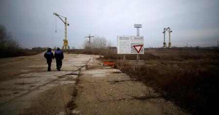 FILE PHOTO: Workers walk near the construction site of Bulgaria's second nuclear power plant in Belene