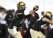 Colorado quarterback Sam Noyer reaches up to grap the snap during the second half of the team's NCAA college football game against San Diego State on Saturday, Nov. 28, 2020, in Boulder, Colo. (AP Photo/David Zalubowski)