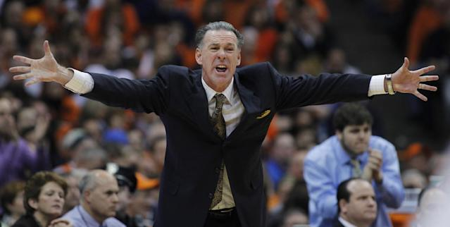 Pittsburgh's head coach Jamie Dixon yells to his players in the second half of an NCAA college basketball game against Syracuse, Saturday, Jan. 18, 2014, in Syracuse, N.Y. Syracuse won 59-54. (AP Photo/Nick Lisi)
