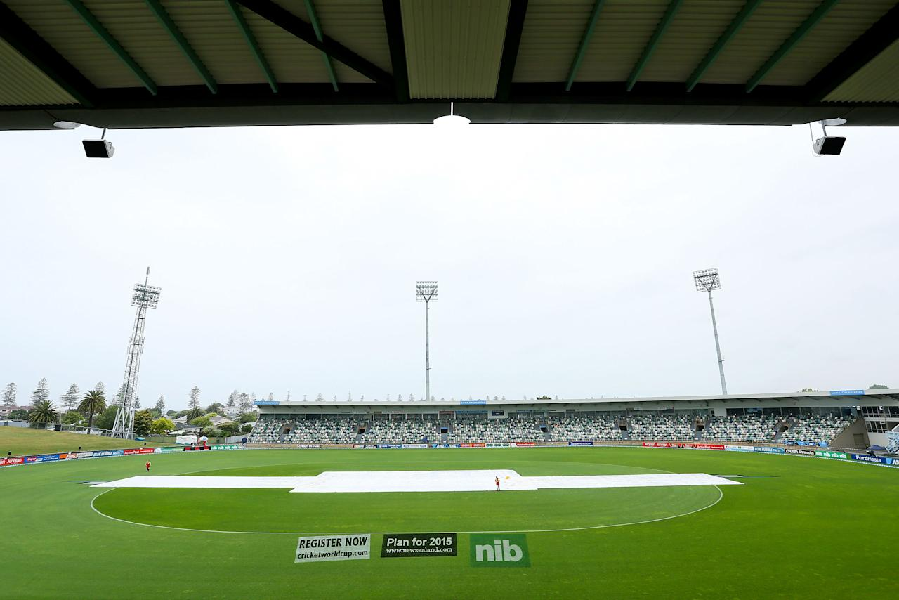 NAPIER, NEW ZEALAND - DECEMBER 29:  Covers protect the wicket during a rain delay prior to game two of the One Day International series between New Zealand and the West Indies at McLean Park on December 29, 2013 in Napier, New Zealand.  (Photo by Hagen Hopkins/Getty Images)