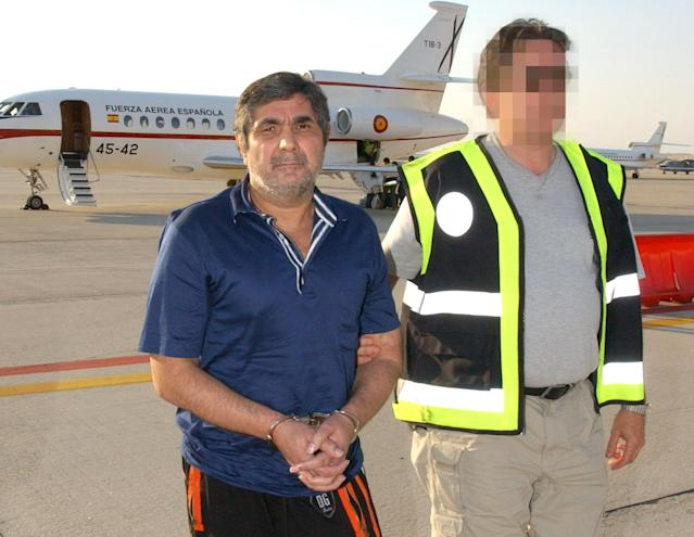 Zakhar Kalashov, the alleged head of the Georgian mafia, is escorted on arrival at the Torrejon military air base outside Madrid in 2006. (Photo: Spanish Interior Ministry/Handout via Reuters)