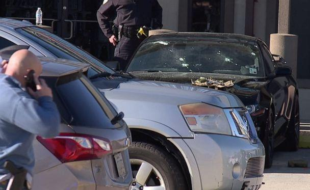 PHOTO: Bullet holes are seen in the front windshield of a car parked at Jefferson Gun Shop in Metairie, La., where three people were killed on Feb. 20, 2021. (WGNO/NewsNation)
