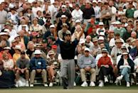 <p>Tiger Woods stretches before his putt on the 18th green during second round Masters play at the Augusta National Golf Club in Augusta, Ga., Friday, April 11, 1997. Woods shot a 66 to take the lead in the trounament. (AP Photo/ Curtis Compton) </p>