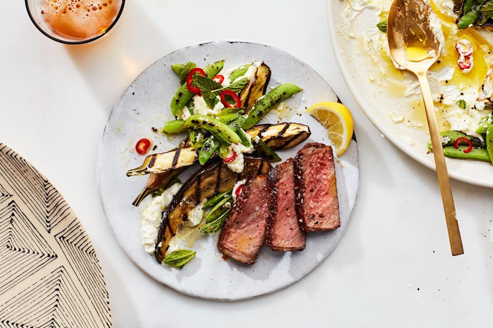 """No pots or pans needed for this easy summertime recipe: The eggplant spears and sugar snap peas are charred side by side on the grill, and they perfectly complement a simple grilled steak. The lemony whipped ricotta provides a creamy brightness to balance out the smoky meat and veg. <a href=""""https://www.epicurious.com/recipes/food/views/grilled-steak-with-peas-and-eggplant-over-whipped-ricotta?mbid=synd_yahoo_rss"""" rel=""""nofollow noopener"""" target=""""_blank"""" data-ylk=""""slk:See recipe."""" class=""""link rapid-noclick-resp"""">See recipe.</a>"""