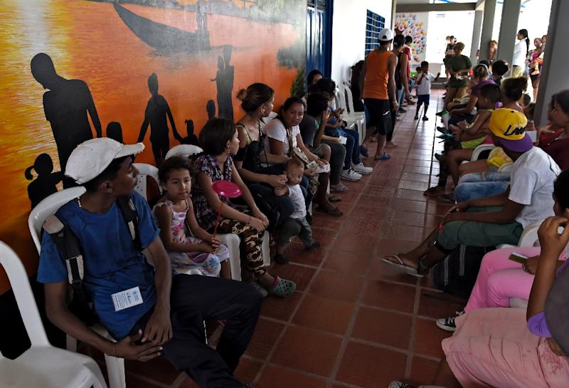 Of Arauca's 93,000 inhabitants, 16 percent are registered Venezuelan migrants, many of whom rely on charities for food such as the soup kitchen pictured here (AFP Photo/Juan BARRETO)