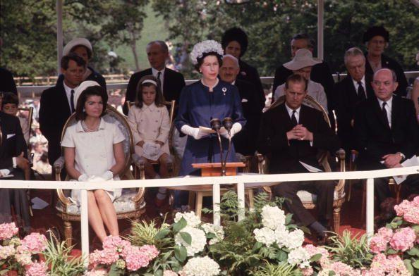 <p>Caroline (pink headband), sits behind Queen Elizabeth II and her mother, Jacqueline Kennedy, at the inauguration of Britain's JFK Memorial at Runnymede. </p>