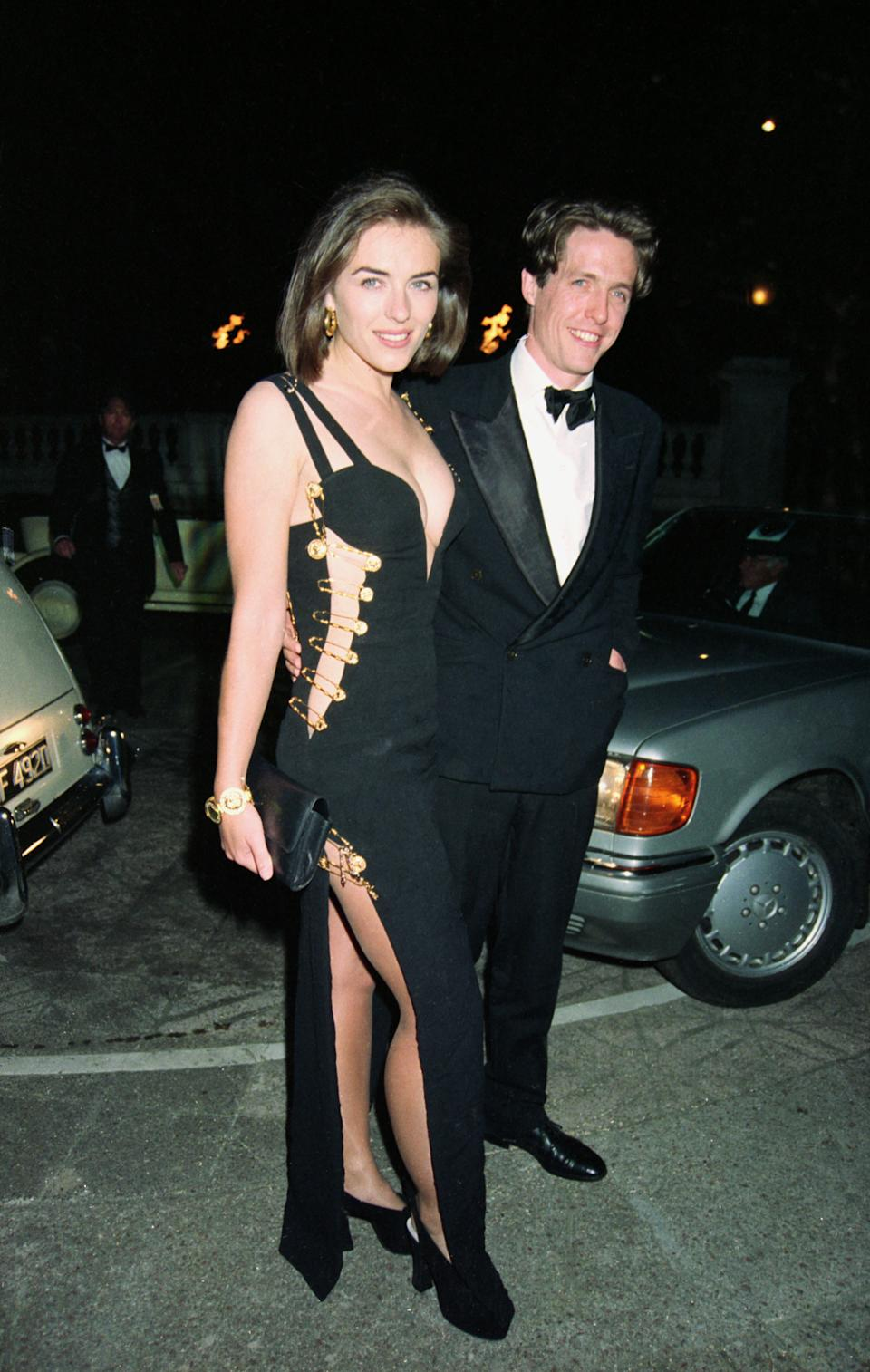 The black Versace gown was held together by oversized gold safety pins [Image: Getty]