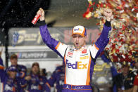 NASCAR Cup Series driver Denny Hamlin (11) celebrates in victory lane after winning a NASCAR Cup Series auto race at the Las Vegas Motor Speedway Sunday, Sept. 26, 2021, in Las Vegas. (AP Photo/Steve Marcus)