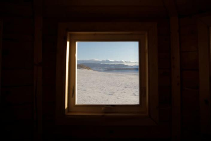 A view through the window of a lookout tower at a survival camp