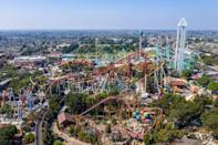 """<p>Picture it: a Blockbuster theme park fit with sports arenas, an amusement park, and full-service production studios. Well, in the early '90s, Blockbuster dumped a reported $30 million into <a href=""""https://www.latimes.com/archives/la-xpm-1994-07-24-mn-19167-story.html"""" rel=""""nofollow noopener"""" target=""""_blank"""" data-ylk=""""slk:the development"""" class=""""link rapid-noclick-resp"""">the development</a> of a Florida-based amusement park that would have given Walt Disney World a run for its money. However, the project was put to rest following the Blockbuster/Viacom merger in 1994. </p>"""