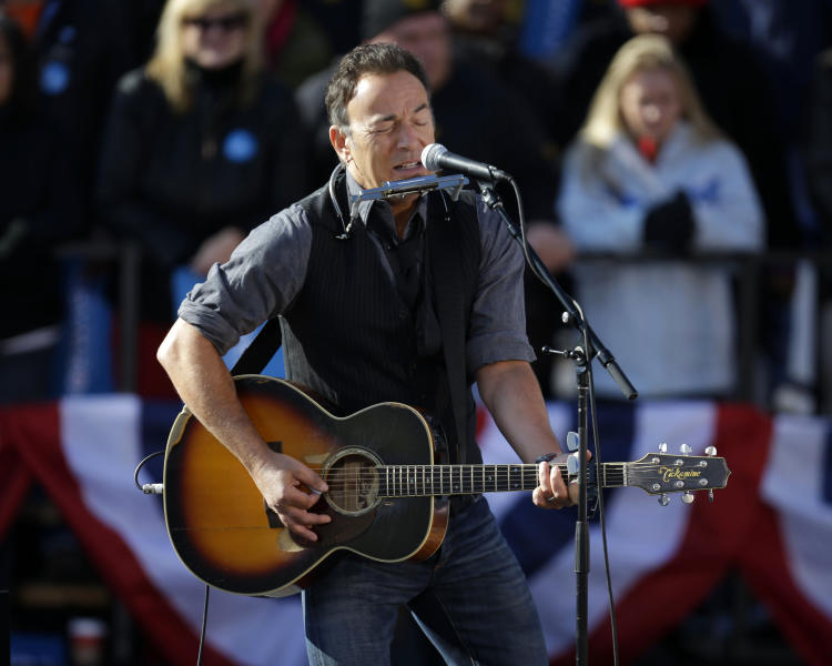 Singer Bruce Springsteen performs before the start of a campaign event for President Barack Obama near the State Capitol Building in Madison, Wis., Monday, Nov. 5, 2012. (AP Photo/Pablo Martinez Monsivais)