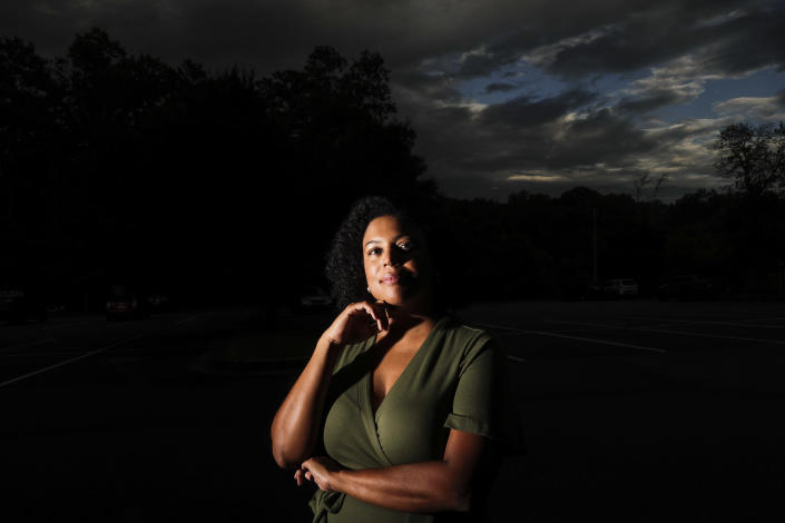 """FILE - In this Friday, July 24, 2020 file photo, Charisse Davis poses for a portrait in Marietta, Ga. Davis, who serves on the school board in suburban Cobb County, was part of a wave of Black women elected to public office in recent years. Women like her led the charge that ushered Joe Biden to an unlikely victory in Georgia. """"We won, but it doesn't really feel like we did,"""" she said. (AP Photo/Brynn Anderson)"""