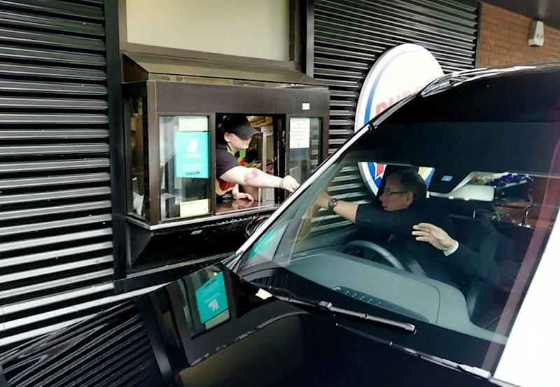A hearse has been spotted going through a Burger King drive-thru in order to fulfil a great-granddad's dying wish - for one final double bacon cheeseburger. See SWNS story SWLEfuneral. Leonard Durkin's funeral cortege pulled into the fast food joint and stunned diners watched on as the vehicle containing his casket placed an order at the window. After the dapper driver paid £4.49 for the snack he got out the car, opened the boot and placed it on top of Leonard's coffin. His son, Peter, 50, said the two of them would visit Burger King once a week after going to his mum's grave in Leeds, West Yorks, and that his dad had requested the unusual tribute before his death on May 28. At the end of the ceremony at a nearby crematorium, as the coffin was taken away to be burned, the Johnny Cash classic 'Ring of Fire' rang out over the sound system.
