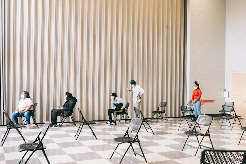 Voters sit in a social distanced line while waiting to cast a ballot for the Senate runoff elections at a polling location in Atlanta, Georgia. (Photographer: Aboubacar Kante/Bloomberg via Getty Images)