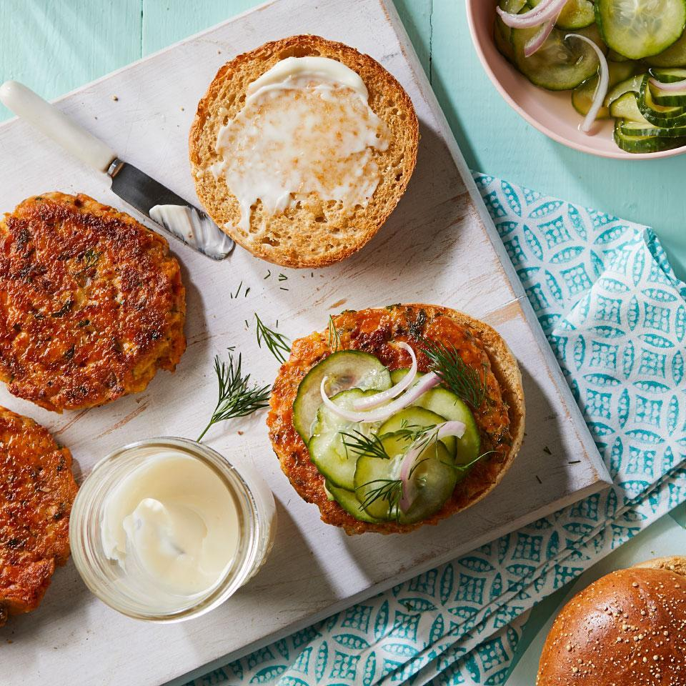 "<p>These healthy salmon burgers call for canned salmon, which makes them an economical and easy dinner. The quick-pickled cucumbers in this recipe are a great introduction to the world of pickling. If you enjoy them, you can make additional batches by following Steps 1 and 2. <a href=""http://www.eatingwell.com/recipe/273181/salmon-burgers-with-quick-pickled-cucumbers/"" rel=""nofollow noopener"" target=""_blank"" data-ylk=""slk:View recipe"" class=""link rapid-noclick-resp""> View recipe </a></p>"