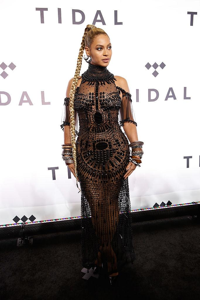 Beyoncé poses on the black carpet at the Tidal Philanthropic Festival. (Photo: Getty Images)