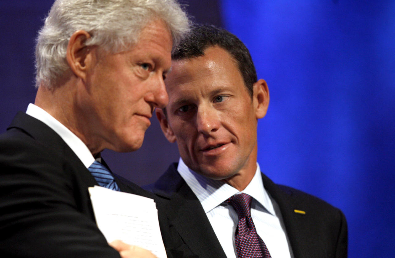 Cyclist Lance Armstrong, right, speaks to former President Bill Clinton during the opening plenary of the Clinton Global Initiative annual meeting Wednesday, Sept 24, 2008 in New York. (AP Photo/Jason DeCrow)