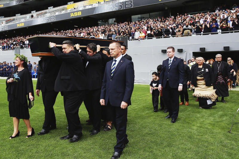 FILE - In this Nov. 30, 2015, file photo, the casket carrying the body of Jonah Lomu is carried onto the field during the public memorial for the former All Black at Eden Park in Auckland, New Zealand. One trampling run launched Jonah Lomu to global stardom and ensured his name will be indelibly linked to a Rugby World Cup semifinal between New Zealand and England. The All Blacks winger's rampaging runs during that era-defining World Cup in South Africa in 1995 were highlighted by his four-try haul against England in the semifinals. New Zealand and England meet again in the semifinals this Saturday, Oct. 26, 2019, at Yokohama.  (Hannah Peters/Pool Photo via AP, File)