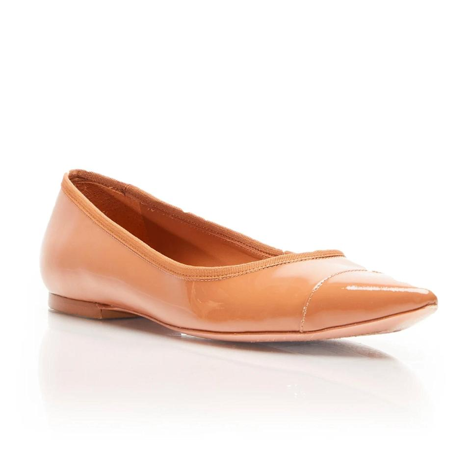 """Who needs fussy bridal heels when you could have Rebecca Allen's line of inclusive nude shoes that cater to Black and Brown women? The cushioned footbed, chic pointed-toe design, and high-quality leather construction will make you forget about the existence of stilettos. $150, Rebecca Allen. <a href=""""https://rebecca-allen.com/collections/footwear/products/the-skim-nude-iii"""" rel=""""nofollow noopener"""" target=""""_blank"""" data-ylk=""""slk:Get it now!"""" class=""""link rapid-noclick-resp"""">Get it now!</a>"""