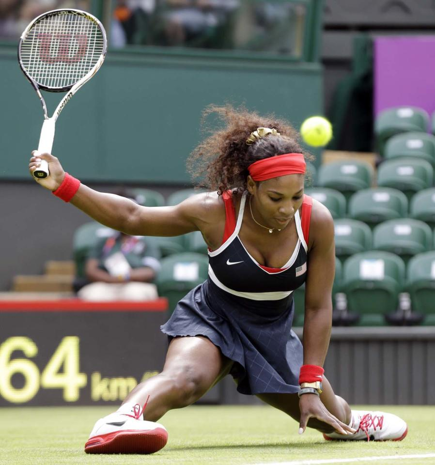 Serena Williams of the United States cannot return the ball as she slips on the grass against Jelena Jankovic of Serbia during a first round match at the All England Lawn Tennis Club in Wimbledon, London at the 2012 Summer Olympics, Saturday, July 28, 2012. (AP Photo/Elise Amendola)