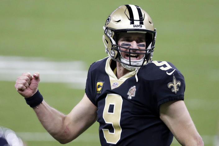 New Orleans Saints quarterback Drew Brees (9) reacts after a touchdown by Alvin Kamara in the second half of an NFL wild-card playoff football game against the Chicago Bears in New Orleans, Sunday, Jan. 10, 2021. (AP Photo/Butch Dill)