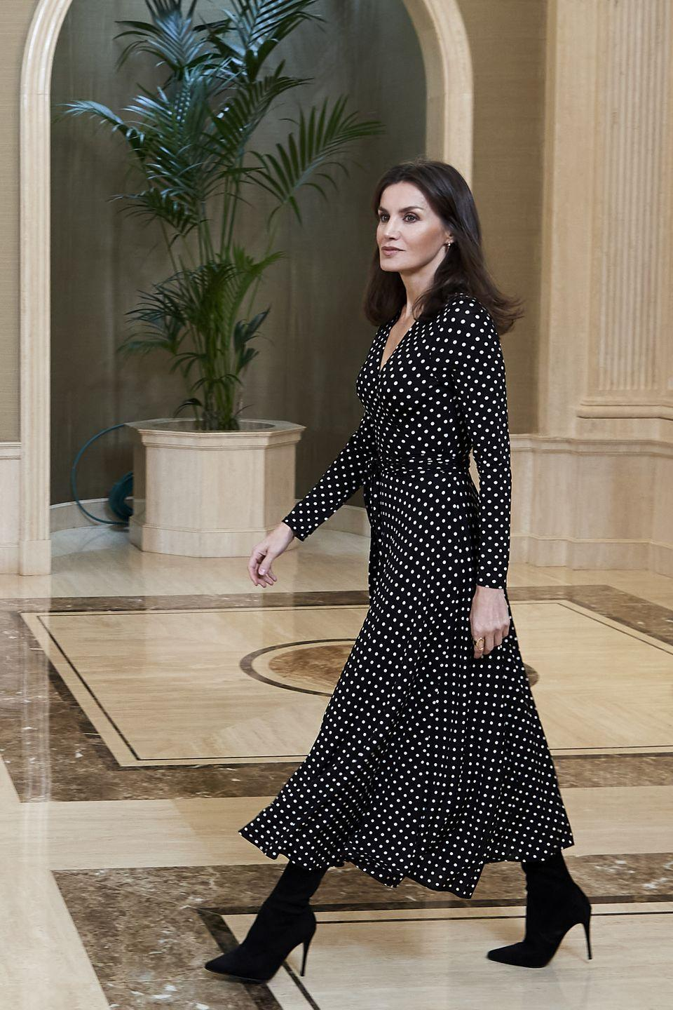 <p>The Queen looked elegant in a black and white polka dot dress and stiletto-heeled booties. </p>