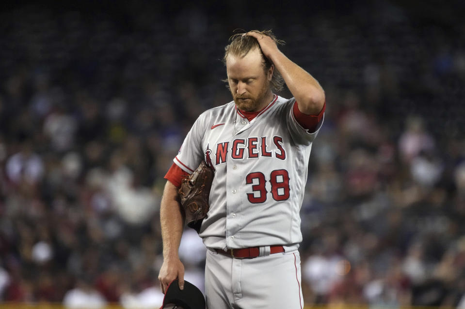 Los Angeles Angels pitcher Alex Cobb reacts after giving up four runs to the Arizona Diamondbacks in the third inning during a baseball game, Saturday, June 12, 2021, in Phoenix. (AP Photo/Rick Scuteri)