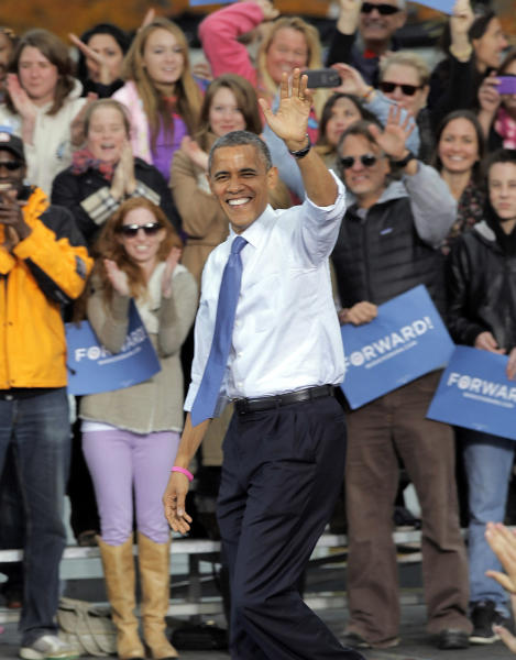 """FILE - In this Oct. 24, 2012 file photo President Barack Obama waves as he arrives to speak at a campaign rally at Denver's City Park. The Aurora massacre, at a midnight showing of the Batman film """"The Dark Knight Rises,"""" occurred in a key swing county in one of the most hotly-contested battleground states in last year's presidential election. But President Barack Obama, seeking re-election, did not bring up gun control. Neither did most Colorado Democrats. (AP Photo/Ed Andrieski, File)"""