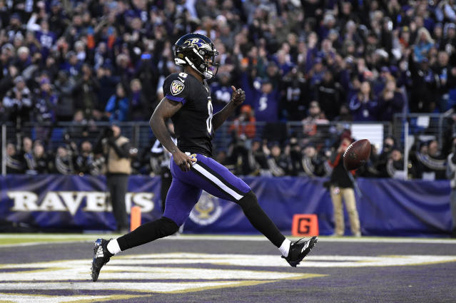 Baltimore Ravens quarterback Lamar Jackson scores a touchdown in the first half of an NFL football gameagainst the Cleveland Browns, Sunday, Dec. 30, 2018, in Baltimore. (AP Photo/Nick Wass)