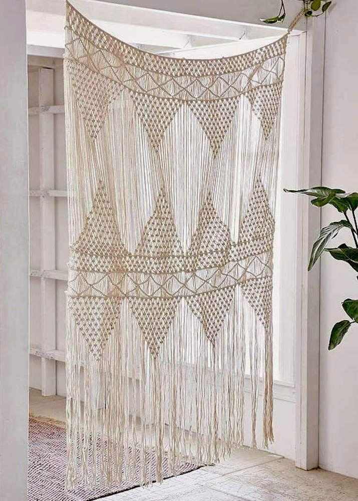 """<h3><a href=""""https://www.amazon.com/Flber-Macrame-Curtain-Hanging-Bohemian/dp/B077T1M2JS/ref=pd_day0_hl_201_3/139-1897040-7376640"""" rel=""""nofollow noopener"""" target=""""_blank"""" data-ylk=""""slk:Flber Macrame Curtain"""" class=""""link rapid-noclick-resp"""">Flber Macrame Curtain</a> </h3><p>Not all room dividers come in free-standing floor form — we love the effortless whimsy and charm that this hand-woven macrame curtain adds when sectioning off a space.</p><br><br><strong>Flber</strong> Macrame Large Hanging Curtain (50"""" x 75""""), $54.72, available at <a href=""""https://www.amazon.com/Flber-Macrame-Curtain-Hanging-Bohemian/dp/B077T1M2JS/ref=pd_day0_hl_201_3/139-1897040-7376640"""" rel=""""nofollow noopener"""" target=""""_blank"""" data-ylk=""""slk:Amazon"""" class=""""link rapid-noclick-resp"""">Amazon</a>"""
